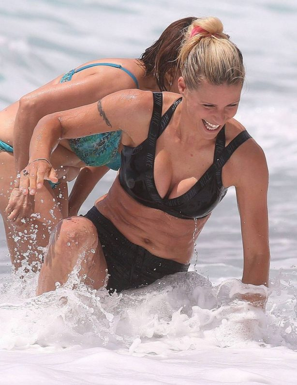 Michelle Hunziker - In bikini top is at the Beach in Varigotti