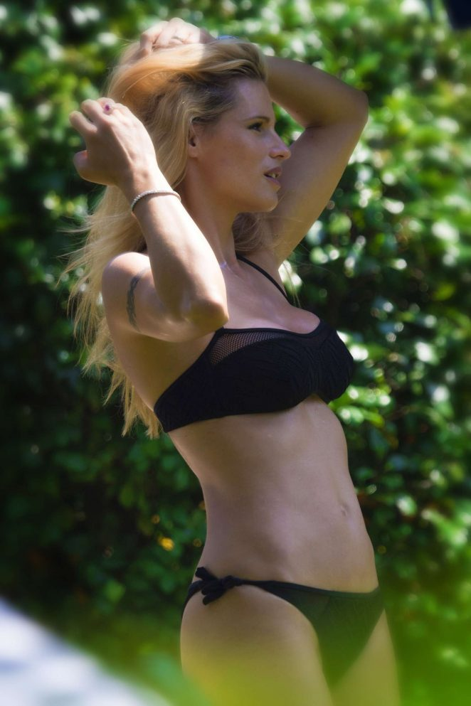 Michelle Hunziker in Black Bikini at the pool in Mendrisio