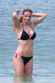 Michelle Hunziker in Black Bikini on the beach in Varigotti