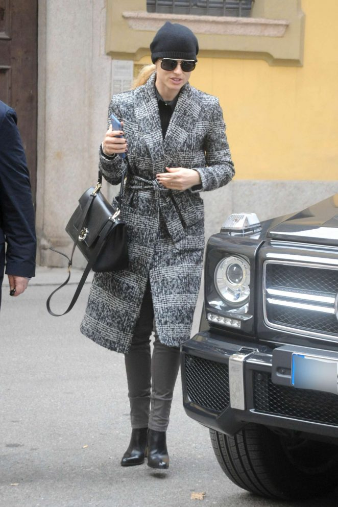 Michelle Hunziker in grey trench coat out in Milan