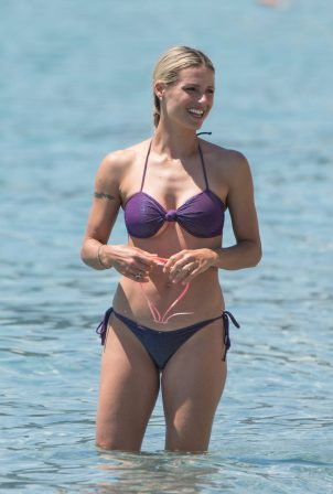 Michelle Hunziker in Purple Bikini on the beach in Varigotti