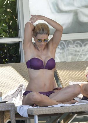 Michelle Hunziker in Purple Bikini on the pool in Milano Marittima