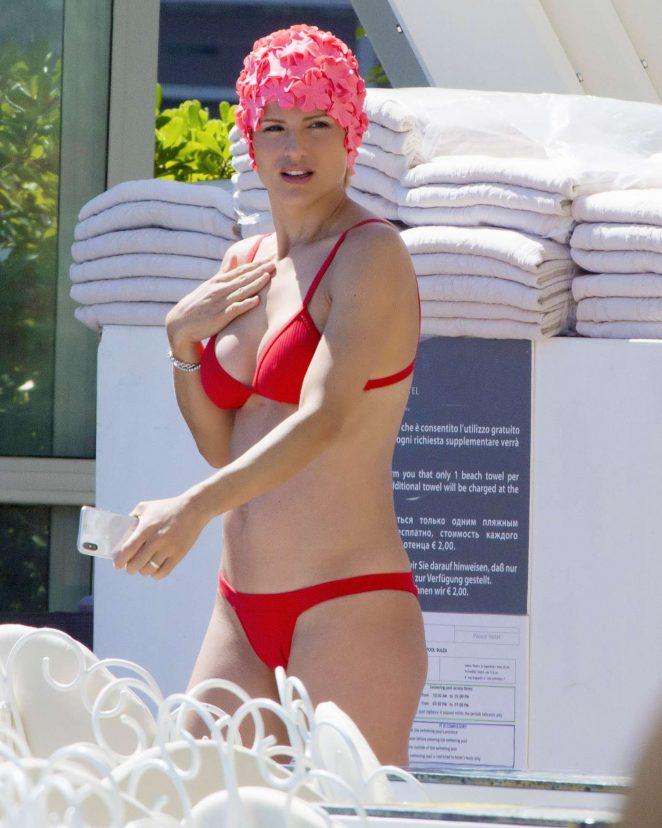 Michelle Hunziker in Red Bikini on the pool in Milano Marittima