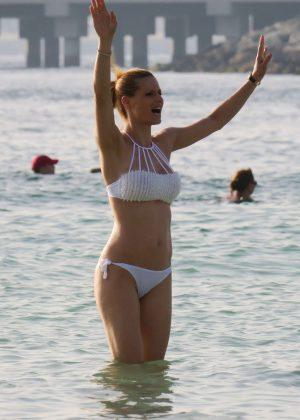 Michelle Hunziker in White Bikini on the beach in Dubai