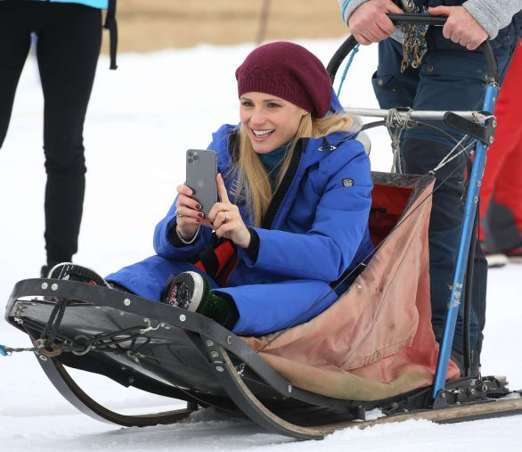 Michelle Hunziker on the dog sled in Sauris