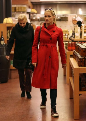 Michelle Hunziker in Red Coat Shopping in Milan