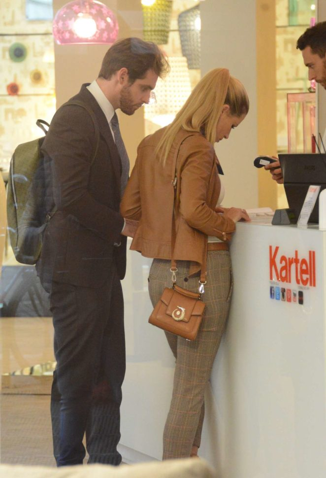 Michelle Hunziker with husband Tomaso Trussardi - Shopping Candids at Kartell in Milan