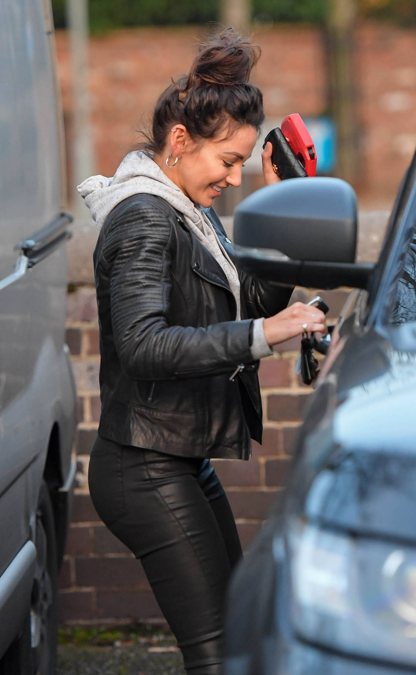 Michelle Keegan - In black leather pants at The Garden cafe