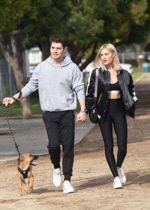 Michelle Randolph and Gregg Sulkin at a park walking their pupp in Los Angeles
