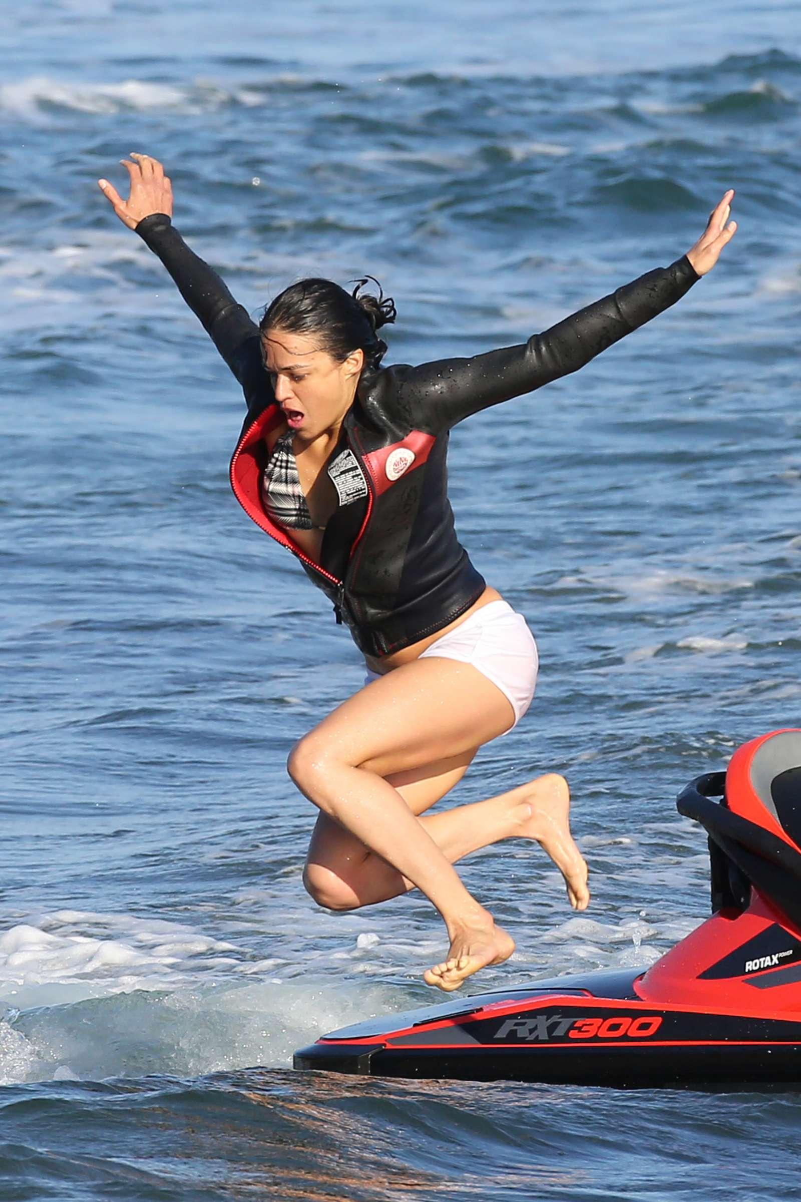 jetski bikini model Michelle Rodriguez in Bikini Paddleboarding in Sardinia