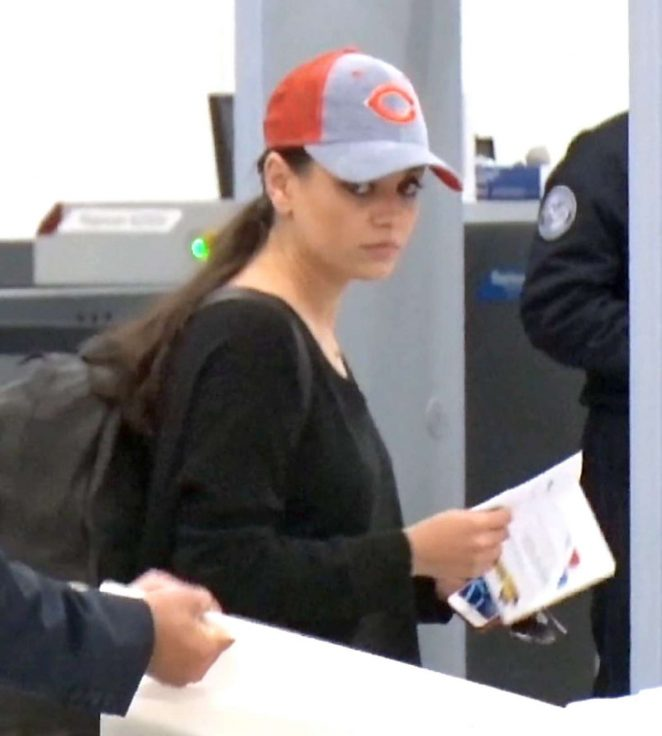 Mila Kunis - Arrives at LAX Airport in Los Angeles