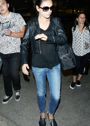 Mila Kunis in Jeans at LAX Airport in LA