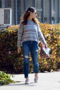 Mila Kunis - In a ripped denim pants out in Los Angeles
