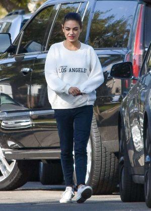 Mila Kunis - Leaving a friends house in Los Angeles