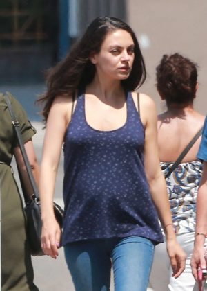 Mila Kunis with a friend out in Los Angeles