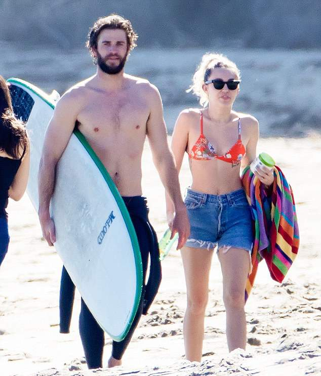 Miley Cyrus and Liam Hemsworth at the beach in Malibu