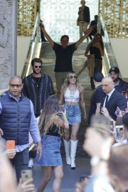 Miley Cyrus and Liam Hemsworth - Leaving The Mandarin Hotel in Barcelona