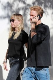 Miley Cyrus hold hands with Cody Simpson - Out for lunch in Los Angeles