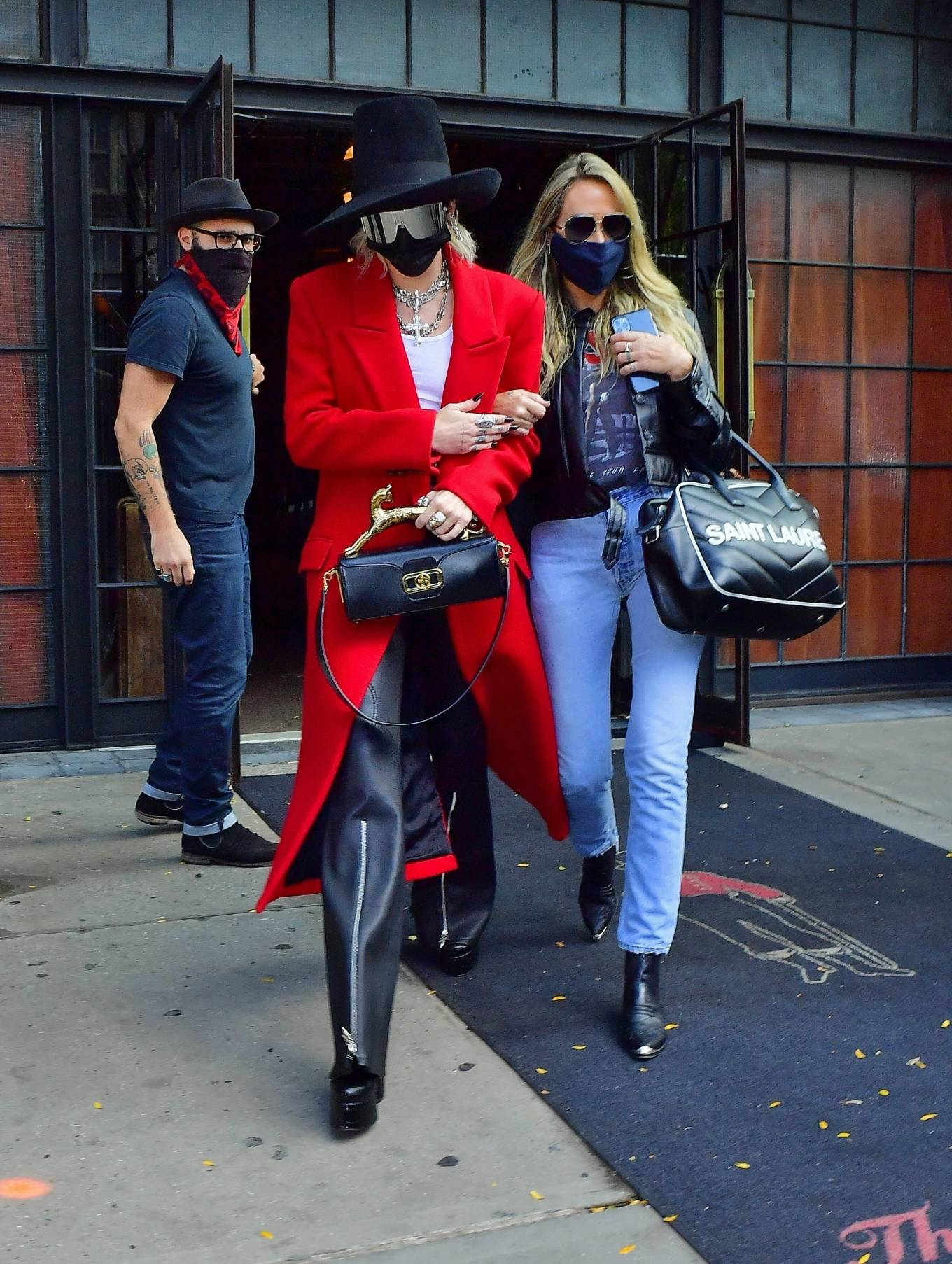 Miley Cyrus - In a red trench coat and black leather pants out in New York