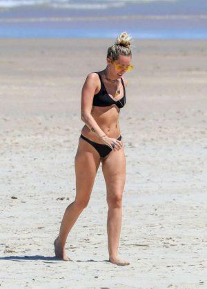 Miley Cyrus in Black Bikini at the beach in Byron Bay Pic 3 of 35