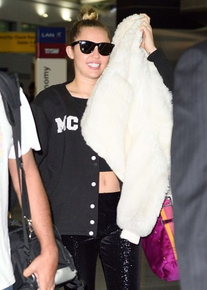 Miley Cyrus in Tights at JFK Airport in New York