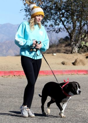 Miley Cyrus in Tights goes for a walk with his dog in LA