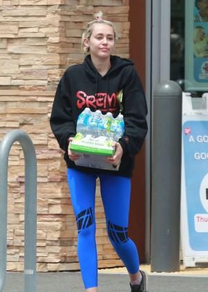 Miley Cyrus in Blue Leggings -01