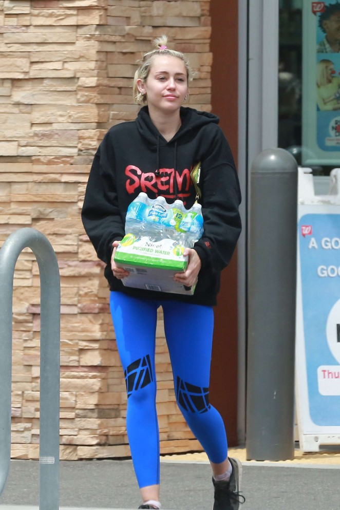 Miley Cyrus in Blue Leggings -01