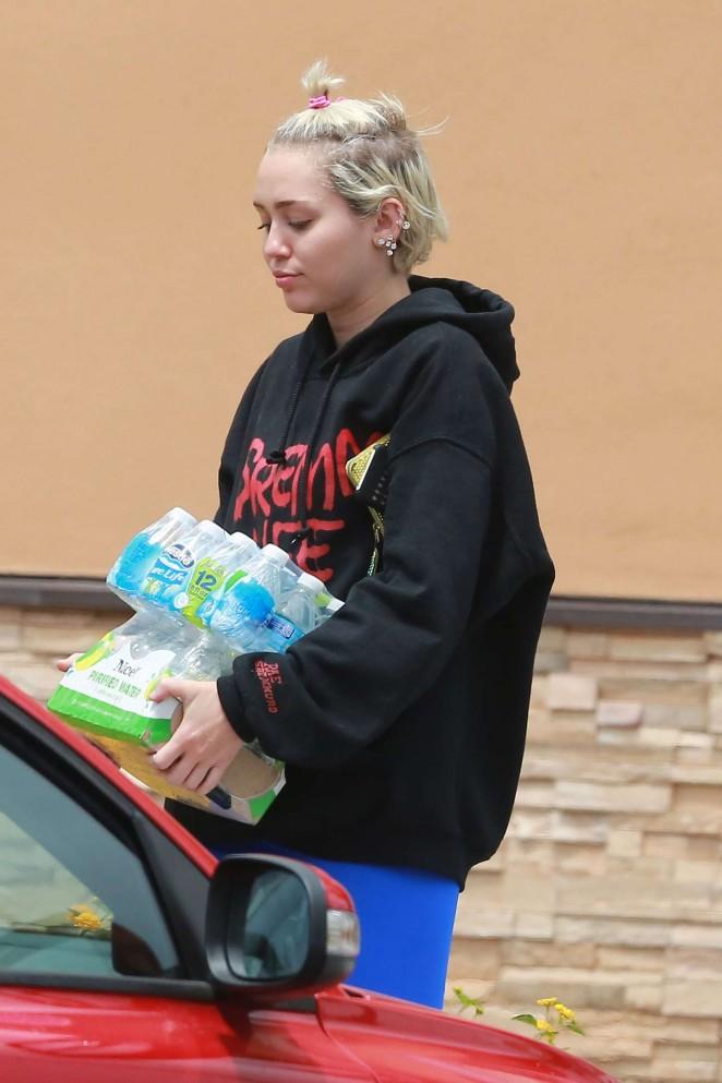 Miley Cyrus in Blue Leggings -03