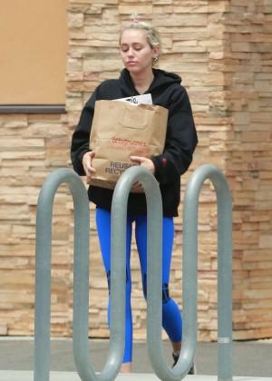Miley Cyrus in Blue Leggings -05