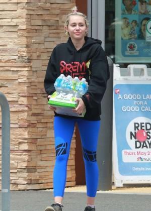 Miley Cyrus in Blue Leggings -09