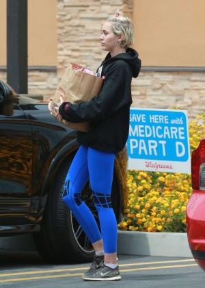 Miley Cyrus in Blue Leggings -15