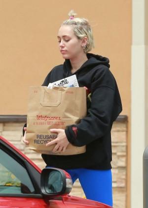 Miley Cyrus in Blue Leggings -18