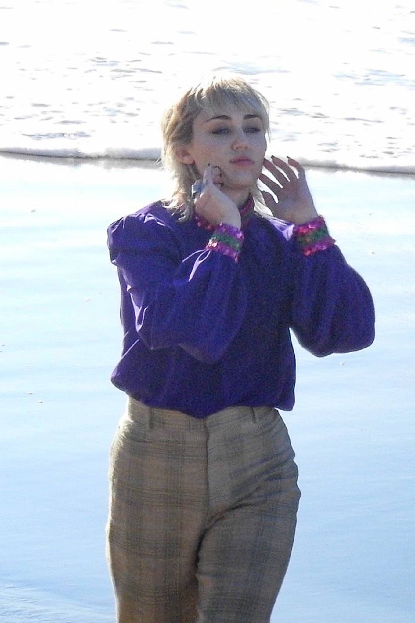 Miley Cyrus - Pictured while shooting a new music video in Malibu