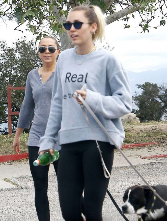 Miley Cyrus with her dog hikking in Studio City