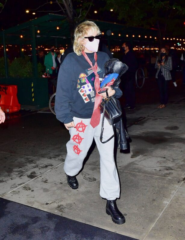 Miley Cyrus - With her mother Tish arrive at JFK Airport in New York