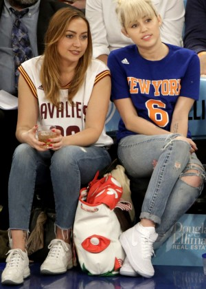 Miley Cyrus with sister Brandi at the Knicks game in NY