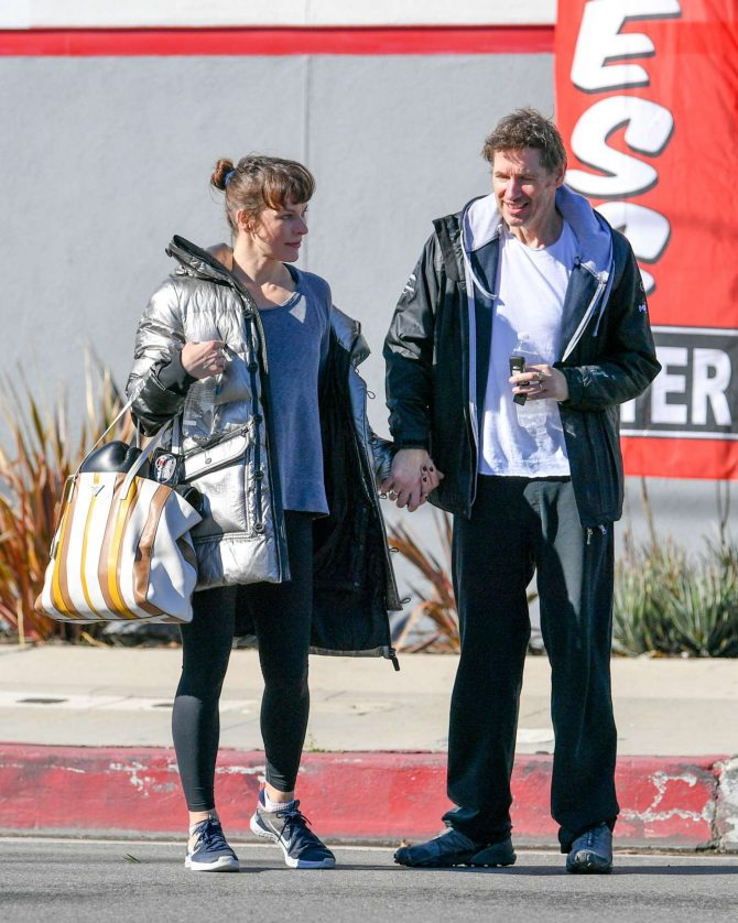 Milla Jovovich and Paul Anderson - Leaving the gym in Los Angeles