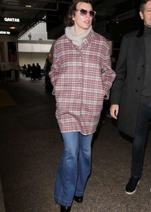 Milla Jovovich - Arrives at LAX Airport in Los Angeles