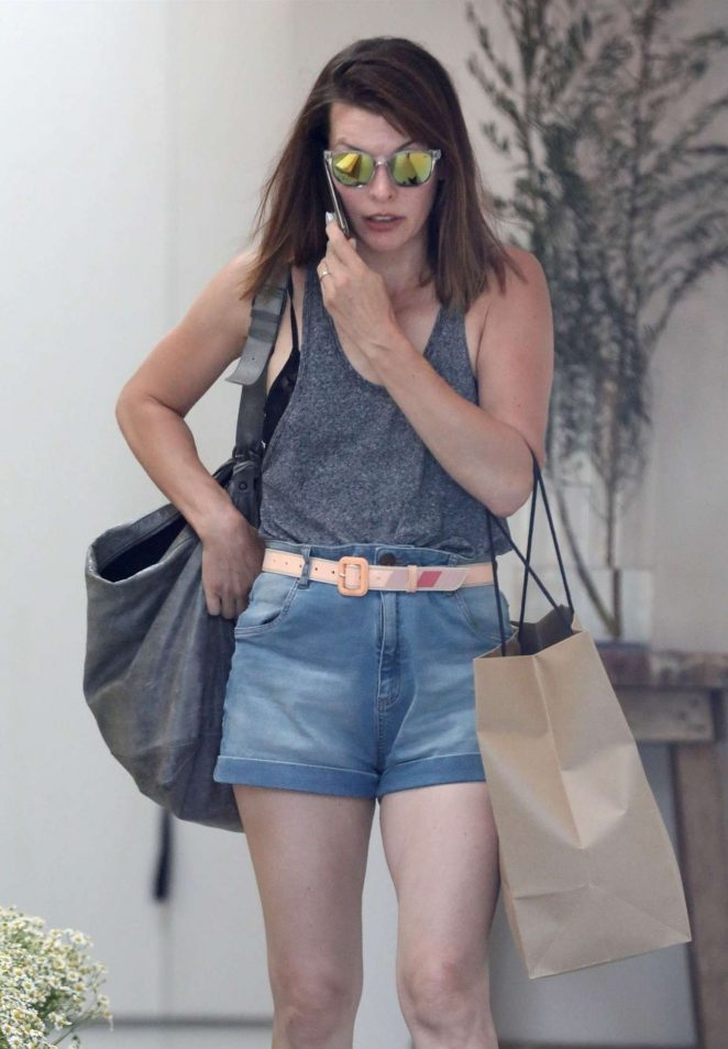 Milla Jovovich in Denim Shorts – Shopping in West Hollywood