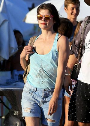 Milla Jovovich in Jeans Shorts out in Malibu