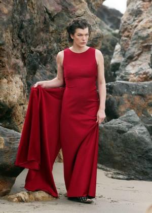 Milla Jovovich in Red Dress on Photoshoot in Malibu