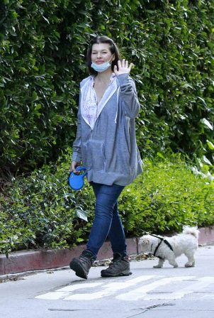 Milla Jovovich - Walking her dogs in Beverly Hills