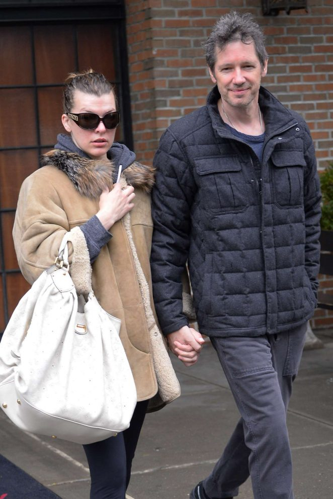 Milla Jovovich with husband - Leaves the Bowery Hotel in New York City