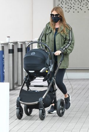 Millie Mackintosh - Arriving back in London