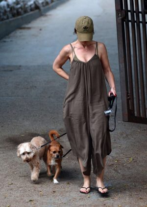 Minka Kelly with her dog at a park in West Hollywood