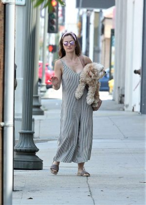 Minka Kelly with her dog out in La Quinta