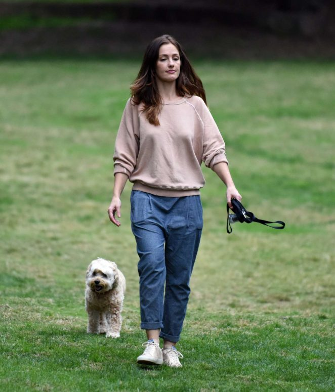 Minka Kelly with her Dogs at a park in Los Angeles