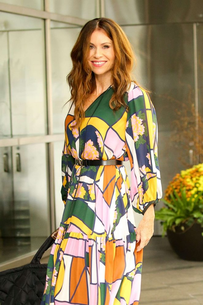Minnie Driver in a colorful long dress in New York City