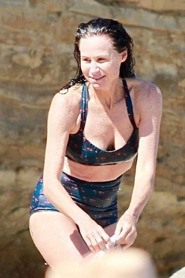 Minnie Driver - In bikini on the beach with her boyfriend in Malibu